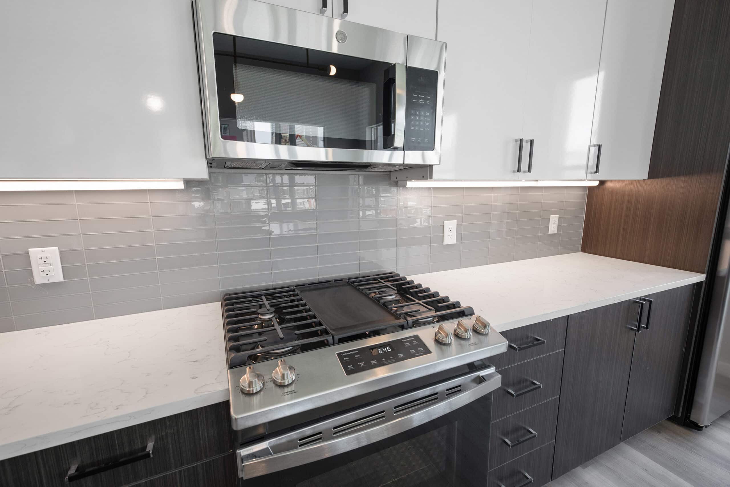 gas-range stove and microwave in apartment kitchen