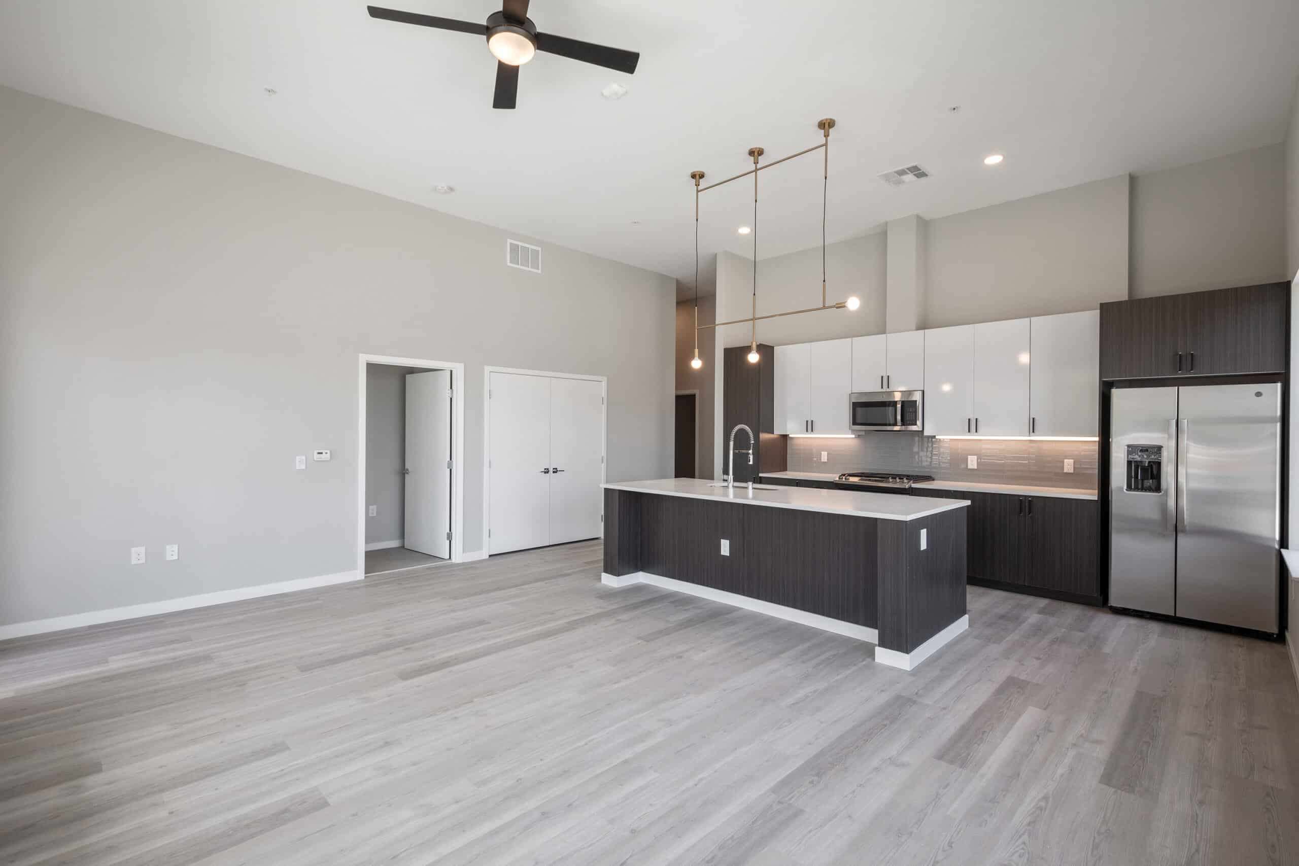 unfurnished apartment living room and kitchen at Auric Symphony Park