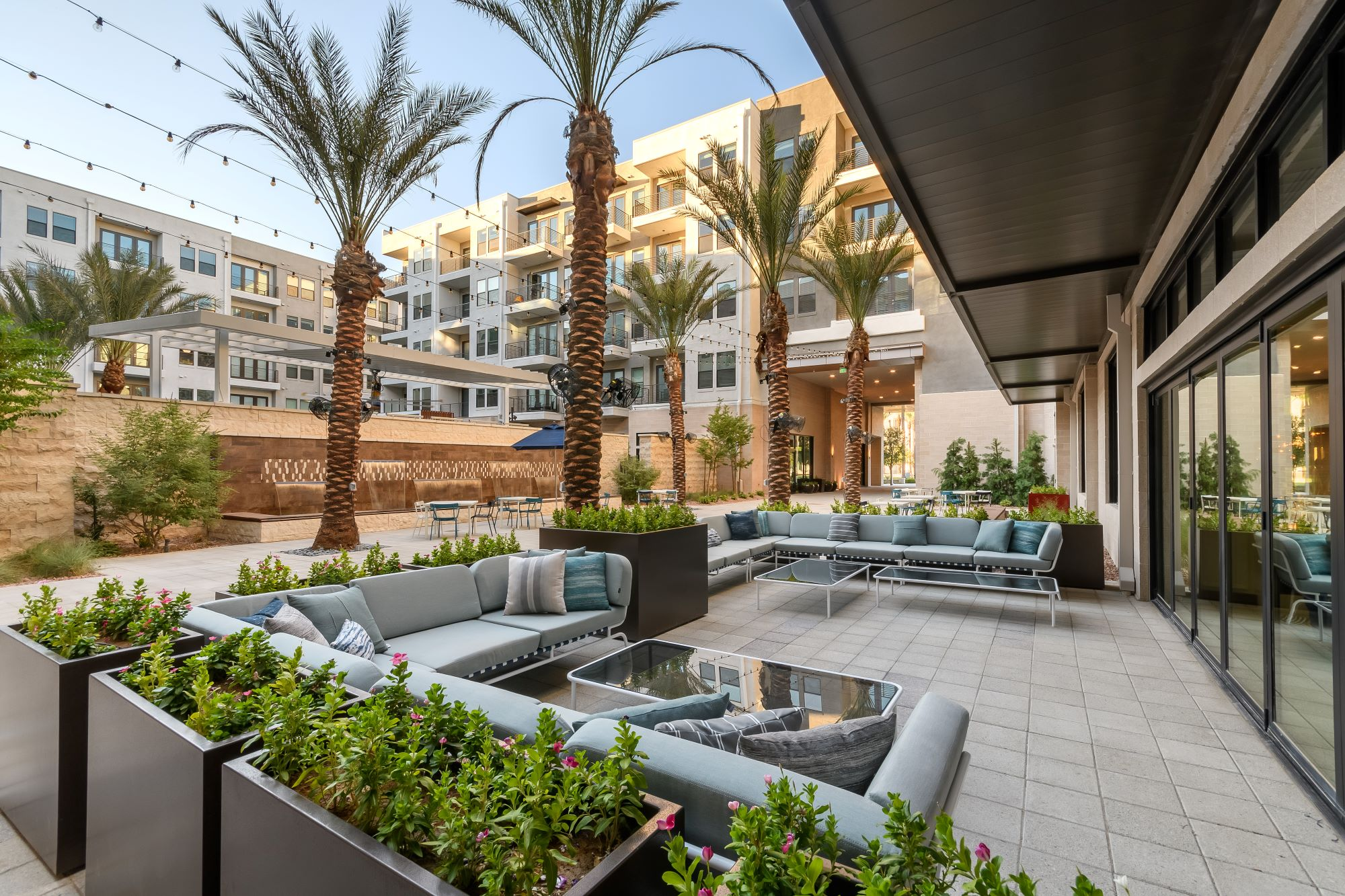 outdoor resident lounge area by the Auric Symphony Park fountain feature