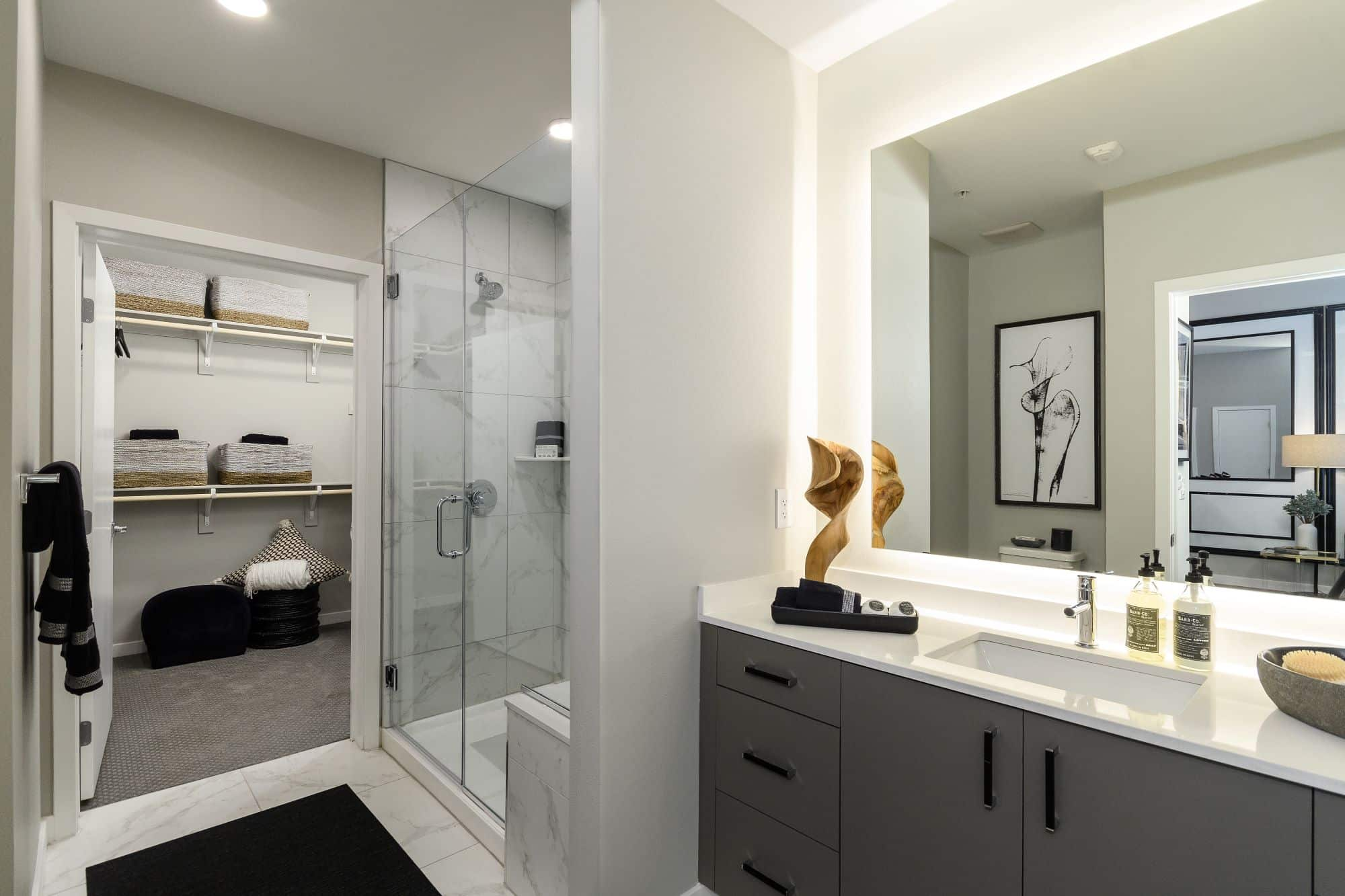 bathroom with a stand-up shower and spacious vanity at Auric Symphony Park apartments in Las Vegas