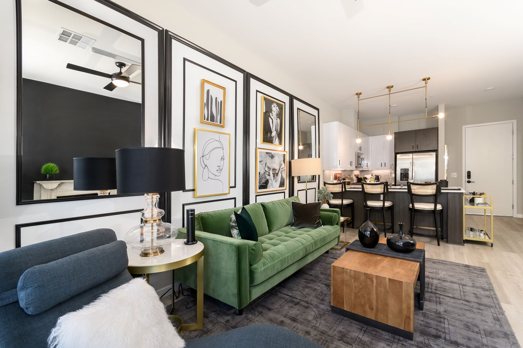 furnished apartment living room and kitchen at Auric Symphony Park in Las Vegas